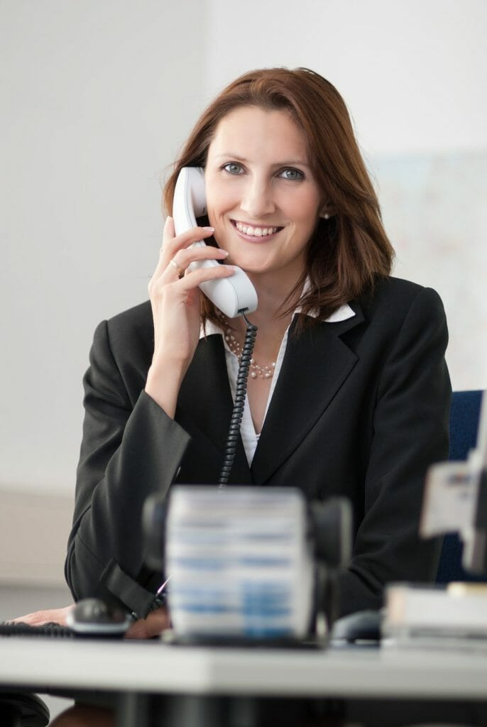 Young businesswoman phones